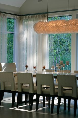 Contemporary Dining Room with High ceiling, Concrete floors, Polished porcelain floor and wall tile, Chandelier