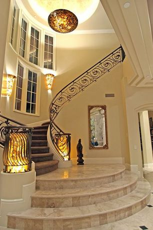 Contemporary Staircase with simple marble tile floors, Wall sconce, High ceiling, Crown molding, Pendant light