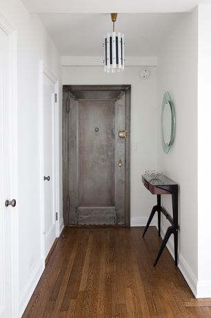 Contemporary Entryway with flush light, Standard height, flat door, Hardwood floors