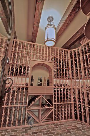 Traditional Wine Cellar with Brick floors, Pendant light, Built-in bookshelf, Exposed beam, French doors