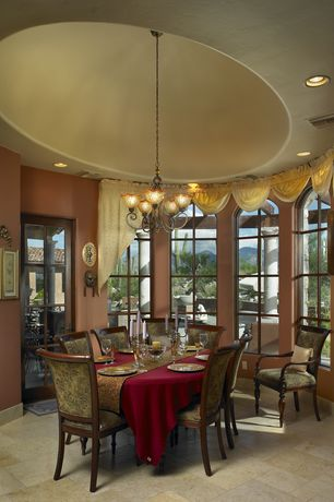 Traditional Dining Room with Arched window, Chandelier, limestone tile floors, Glass panel door, High ceiling