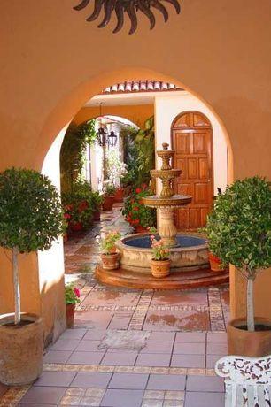 Mediterranean Patio with Fountain, Pathway, exterior stone floors