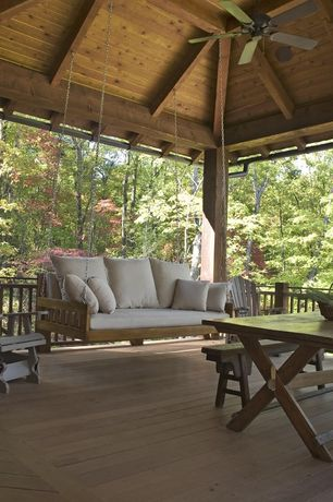 Rustic Porch with Wood dining table, Wood plank ceiling, Ceiling fan, Vista adirondack chair, Porch swing, Deck Railing