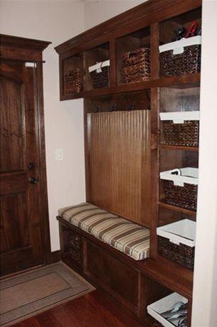 Craftsman Mud Room with Built-in bookshelf, specialty door, Hardwood floors