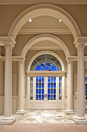 Traditional Entryway with Arched doorway, French doors, Transom window, Cathedral ceiling, Paint, Columns, can lights