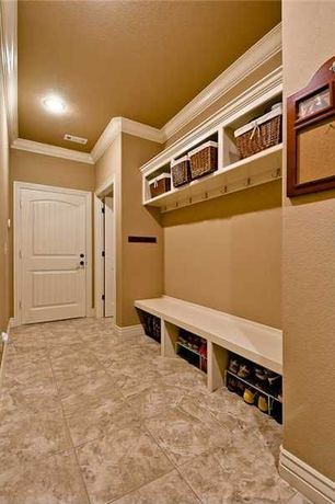 Traditional Mud Room with Crown molding, specialty door, Daltile travertine in bianco, travertine tile floors