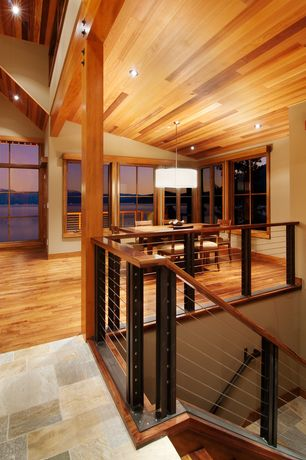 Contemporary Staircase with High ceiling, Exposed beam, Hardwood floors, Metal staircase