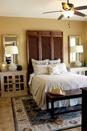 Eclectic Master Bedroom with Ceiling fan, travertine floors