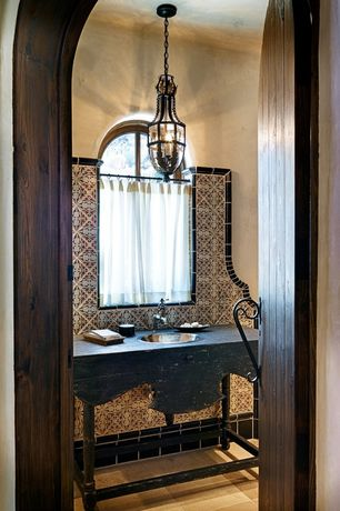 Mediterranean Powder Room with drop-in sink, Arched door, full backsplash, High ceiling, Pendant light, Arched window