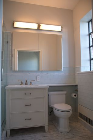 Traditional 3/4 Bathroom with Flat panel cabinets, ceramic tile floors, Dupont Corian Designer White, Undermount sink