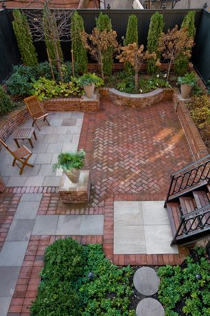 Traditional Patio with Pathway, Raised beds, Fence, exterior brick floors