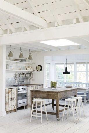 Cottage Kitchen with Breakfast nook, BassamFellows Tractor Barstool, Pendant light, Kitchen island, Stainless Steel, Skylight