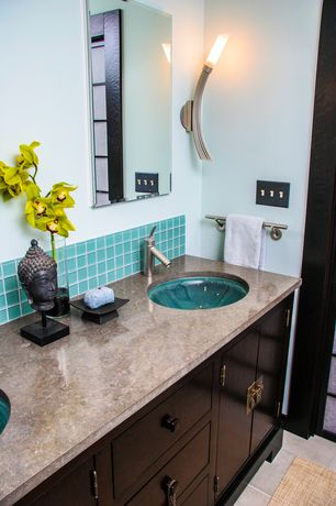 Asian Full Bathroom with Undermount sink, Glass Tile, Limestone counters, Serif Undermount bathroom sink, specialty door