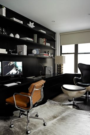 Eclectic Home Office with Built-in bookshelf, Hardwood floors