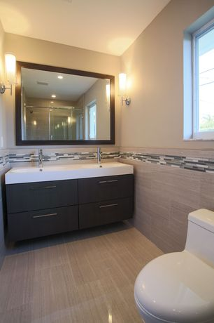 Contemporary Master Bathroom with Corian counters, Cylinder glass bath sconce, Double sink, Undermount sink, Wall sconce
