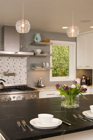 Contemporary Kitchen with can lights, Subway Tile, electric cooktop, Kitchen island, Breakfast nook, Pot filler faucet
