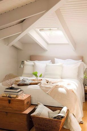 Traditional Guest Bedroom with Exposed beam, Hardwood floors, Skylight