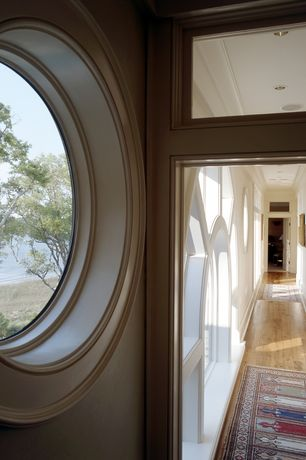 Traditional Hallway with Arched window, Transom window, Crown molding, Hardwood floors