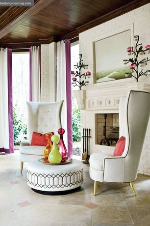 Eclectic Living Room with Exposed beam, limestone tile floors, Tom Dixon Wingback Chair, TANGIER HASSOCK, Crown molding