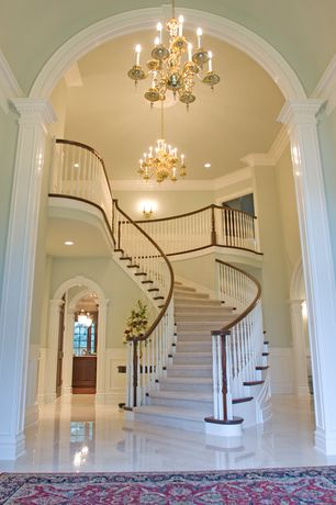 Traditional Staircase with Wall sconce, Wainscotting, Concrete floors, Chandelier, Loft, Cathedral ceiling, Crown molding