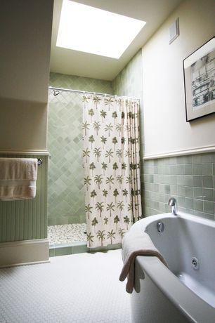 Cottage Full Bathroom with penny tile floors, Freestanding, Daltile Stone Radiance Whisper Green Blend, Wainscoting, Skylight