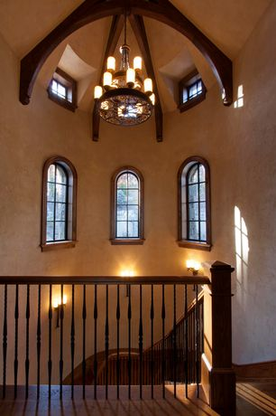 Mediterranean Staircase with Wall sconce, Chandelier, Exposed beam, Cathedral ceiling, Arched window, Hardwood floors