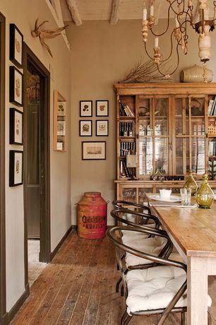 Rustic Dining Room with Built-in bookshelf, Exposed beam, Chandelier, High ceiling, Hardwood floors
