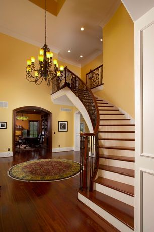 Traditional Staircase with Cathedral ceiling, Loft, Crown molding, specialty door, Chandelier, Laminate floors