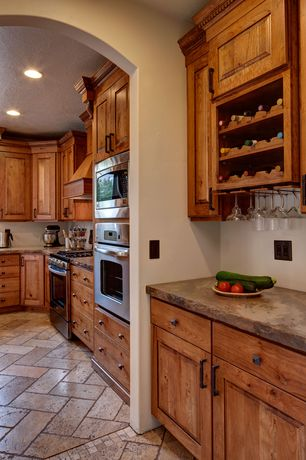 Craftsman Kitchen with wall oven, Custom hood, Raised panel, built-in microwave, Limestone counters, L-shaped, can lights