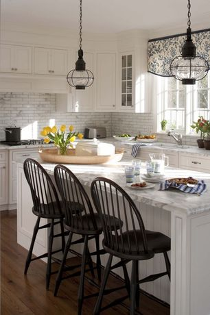 Traditional Kitchen with Complex Marble Tile, Stone Tile, Complex marble counters, Hardwood floors, full backsplash, Casement