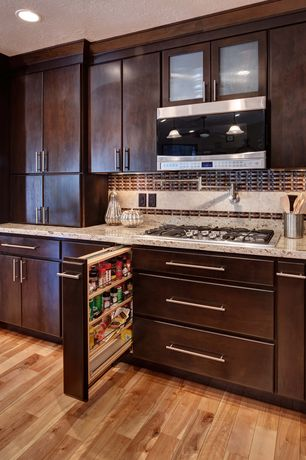 Modern Kitchen with Pendant light, Stone Tile, One-wall, Simple granite counters, electric cooktop, built-in microwave, Flush