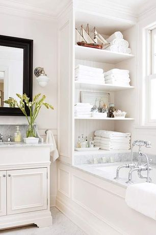 Traditional Full Bathroom with Bathtub, Standard height, drop in bathtub, linen and towel storage cabinet, partial backsplash