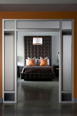 Contemporary Master Bedroom with Concrete floors, Transom window, Pendant light