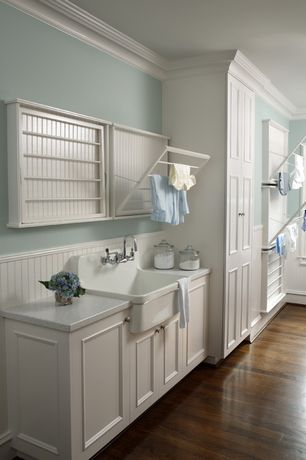 Cottage Laundry Room with Madison Fold-Down Wall-Mounted Laundry Drying Rack, Hardwood floors, Built-in bookshelf