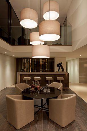 Modern Bar with Loft, Minotti Case Armchair, Hardwood floors, High ceiling, Pendant light
