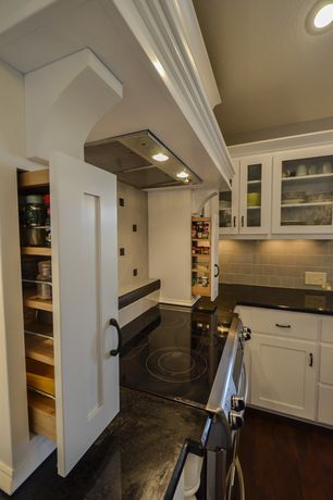 Traditional Pantry with Standard height, Movable cooking spice cupboard, can lights, Paint, Built-in bookshelf