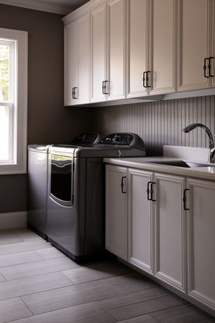 Modern Laundry Room with Laminate floors, laundry sink, Tile floor, Undermount sink, Crown molding, Built-in bookshelf