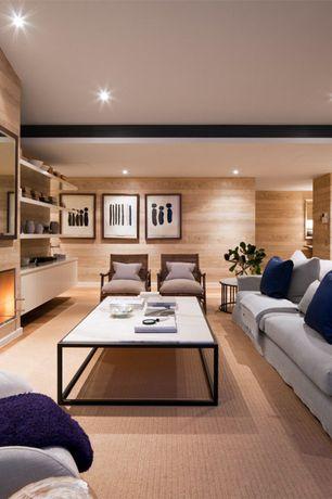 Contemporary Living Room with Hardwood floors, Built-in bookshelf