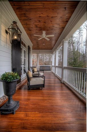 Traditional Porch with Transom window, Deck Railing, Natural beadboard ceiling, House of silk flowers round urn, French doors