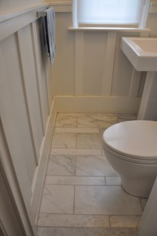 Traditional Powder Room with Pedestal sink, Wainscotting, Powder room, Polished marble floor and wall tile