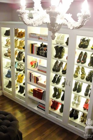 Contemporary Closet with Hardwood floors, Custom shoe storage, Abbyson living tufted storage ottoman, Chandelier
