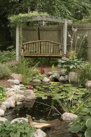 Cottage Landscape/Yard with Wood privacy fence, Western red cedar dog-ear wood fence privacy panel, Hanging chair, Pond