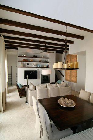 Contemporary Living Room with Ceiling fan, Pendant light, Carpet, Exposed beam, Built-in bookshelf