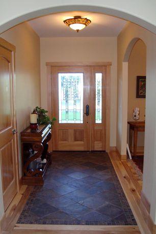 Craftsman Entryway with specialty door, flush light, Hardwood floors, travertine floors