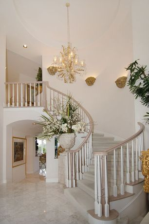 Traditional Staircase with High ceiling, Chandelier, curved staircase, can lights, Concrete tile , Sunken living room