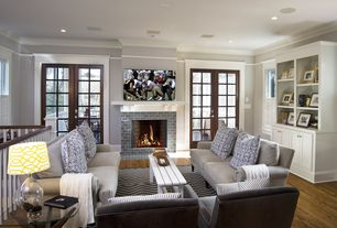 Cottage Living Room with Landon upholstered sofa, Casement, brick fireplace, Fireplace, Logan modular bookcase with doors