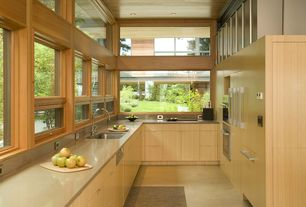 Modern Kitchen with Flush, can lights, dishwasher, double wall oven, partial backsplash, High ceiling, Concrete counters