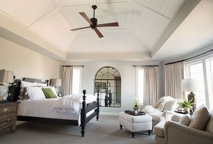 Traditional Master Bedroom with High ceiling, Carpet, Arched window, Casement, Ceiling fan