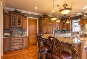 Traditional Kitchen with Raised panel, specialty door, Flush, Pendant light, Complex granite counters, Kitchen island