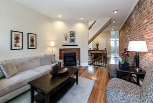 Modern Living Room with Overstock plush oversized leopard print accent chair, Hardwood floors, Exposed brick wall